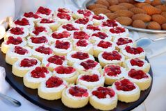 Berry cakes......... Selection of fruit cakes on buffet in the hotel Royalty Free Stock Photo