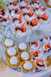 Berry cakes on the table. Cakes of meringue and berries on plate during party stock photos