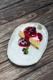 Berry cheese cake on dish Stock Photography