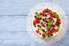 Berry cheesecake with currants, blueberries and raspberries. Royalty Free Stock Photo