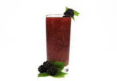 Berry Chia Drink. A berry chia drink garnished with fresh blackberries and leaves on white background. Chia is an edible seed that comes from the desert plant Stock Photo
