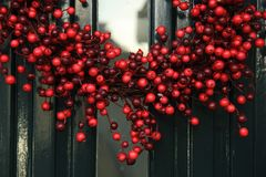 Berry christmas wreath. With decorations on a door royalty free stock photo