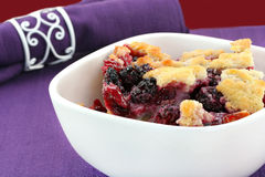 Berry cobbler in a bowl. Berry cobbler, freshly made, in a white bowl stock images