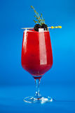 Berry Cocktails for Holiday. On Blue Background. Drink Dressed with Blackberry and Thyme royalty free stock image