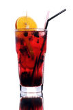 Berry coctail with orange slice. Berry and orange cold cocktail in big glass isolated on white background with reflection Royalty Free Stock Image
