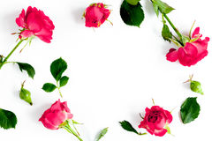 Berry color decorative cosmetics with roses white background top view Royalty Free Stock Photos