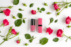 Berry color decorative cosmetics with roses white background top view. Berry color decorative cosmetics with roses on white background top view Stock Photography