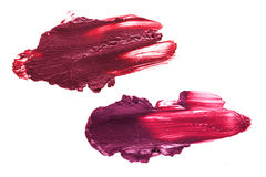 Berry color lipstick smudge. D on a white isolated background Stock Image