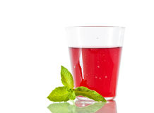Berry compote with mint in glass. Berry compote with fresh mint leaf in glass Royalty Free Stock Images
