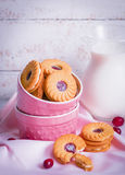 Berry cookies with milk on wooden background Royalty Free Stock Image