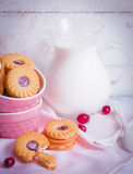 Berry cookies with milk on wooden background Stock Photos