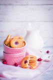 Berry cookies with milk on wooden background Royalty Free Stock Photos