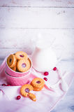 Berry cookies with milk on wooden background Royalty Free Stock Images
