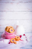 Berry cookies with milk on wooden background Royalty Free Stock Photo