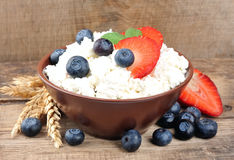 Berry and cottage cheese Royalty Free Stock Image