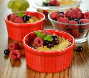 Berry crumble. On a brown table royalty free stock image