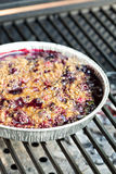 Berry crumble cake made on grill Royalty Free Stock Images