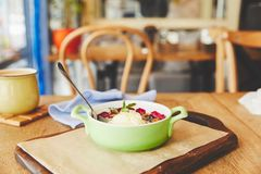 Cobbler pie dessert. Berry crumble served in pot on table with coffee stock image