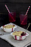Berry crumble. In a white form for roasting Royalty Free Stock Photo