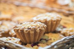 Berry cupcakes in a basket. On the bakery window royalty free stock photo