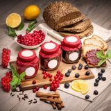 Berry currants, blueberries, currant jam, blueberry jam, jars of jam, bread, min Stock Photography