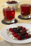 Berry dessert. Canape from fresh berries and compote Stock Image