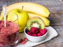 Berry dessert smoothie banana Kiwi Apple Parsley Raspberry Nuts for Breakfast.  Royalty Free Stock Photo