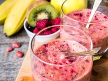 Berry dessert smoothie banana Kiwi Apple Parsley Raspberry Nuts for Breakfast.  Royalty Free Stock Images
