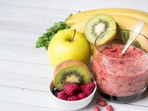Berry dessert smoothie banana Kiwi Apple Parsley Raspberry Nuts for Breakfast.  Stock Photos