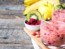 Berry dessert smoothie banana Kiwi Apple Parsley Raspberry Nuts for Breakfast.  Stock Photography