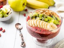 Berry dessert smoothie banana Kiwi Apple Parsley Raspberry Nuts Granule for Breakfast. Berry dessert smoothie banana Kiwi Apple Parsley Raspberry Nuts for Royalty Free Stock Image