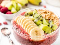 Berry dessert smoothie banana Kiwi Apple Parsley Raspberry Nuts Granule for Breakfast. Berry dessert smoothie banana Kiwi Apple Parsley Raspberry Nuts for Royalty Free Stock Images