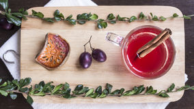 Berry drink with grape, cinnamon and dried balefruit on chopping Stock Images