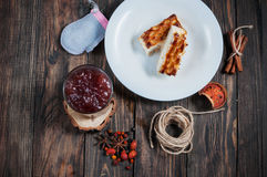 Berry drink. Kissel in glasses with cheese casserole and spices on wood stock photo