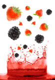 Berry falling in juice. royalty free stock image