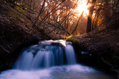 Waterfall on a Creek at Sunset Royalty Free Stock Images
