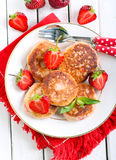 Berry fried cakes Stock Photography