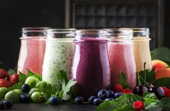 Berry fruit cokctalis, smoothies and milkshakes, fresh fruit and berries on brown table, still life, selective focus. Berry fruit cokctalis, smoothies and royalty free stock images