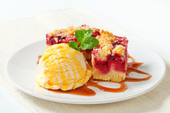 Berry fruit crumble slices with ice cream Stock Photo