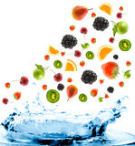 Berry and fruit falling. In juice. Isolation Royalty Free Stock Photos