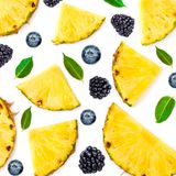 Berry and Fruit  Mix Pattern. Sliced Pineapple, blackberry, green leaves and blueberries  isolated on white background. Flat lay royalty free stock photo