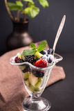 Berry fruit salad in glass bowl Stock Photos