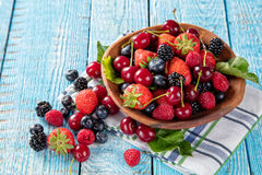 Berry fruit in saucer placed on old wooden planks Royalty Free Stock Photos