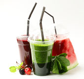 Berry fruit and spinach drink smoothies with cherries, raspberry and watermelon Stock Photography