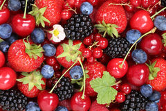 Berry fruits background with strawberries, blueberries and cherr Royalty Free Stock Photos