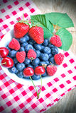 Berry fruits in bowl Royalty Free Stock Photo