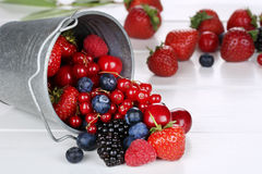 Berry fruits in bucket with strawberries, blueberries, cherries Stock Image
