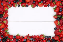 Berry fruits frame with strawberries, blueberries, cherries and Royalty Free Stock Images