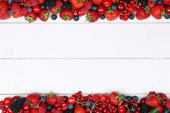 Berry fruits frame with strawberries, raspberries, cherries and Stock Photos