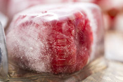 Berry fruits frozen in ice cubes Royalty Free Stock Photo